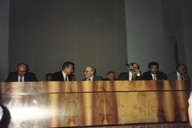 AESA President 1994, Sarkis Barkhoudarian (Center Left) and Victor Hambartsumyan (Center Right) talk during the AESA Victor Hambartsumyan Award ceremony in Armenia 1994.